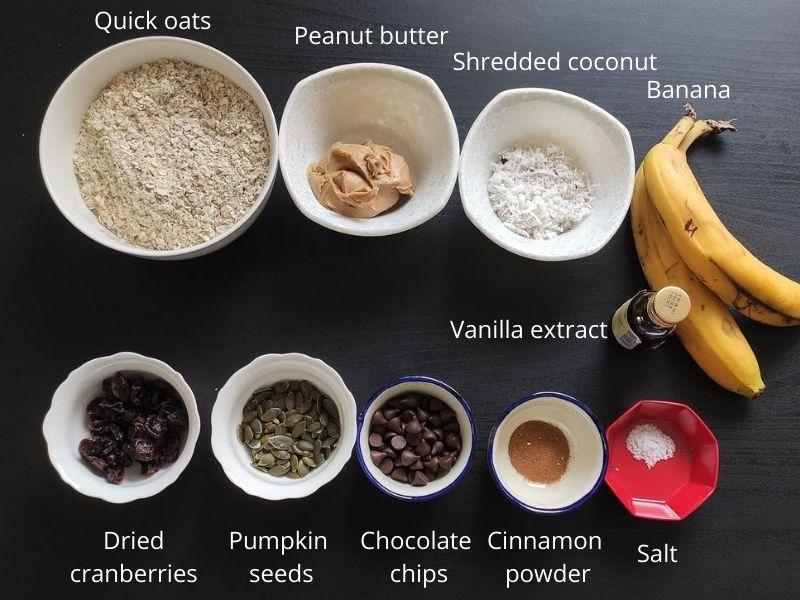 Ingredients of vegan oatmeal cookies kept on a black surface