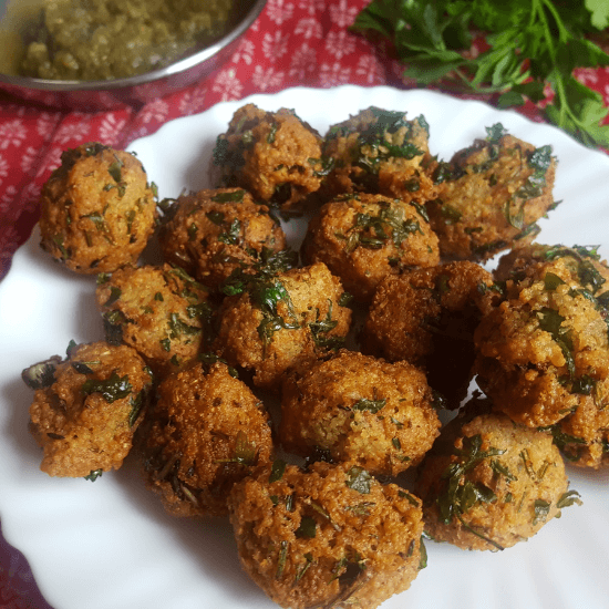 Middle eastern couscous fritters kept on a white plate