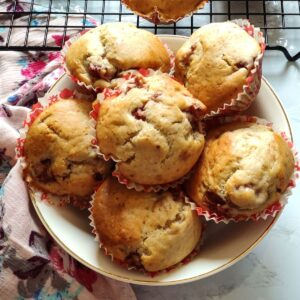 Vegan strawberry muffins served in a white bowl kept on a pink table napkin