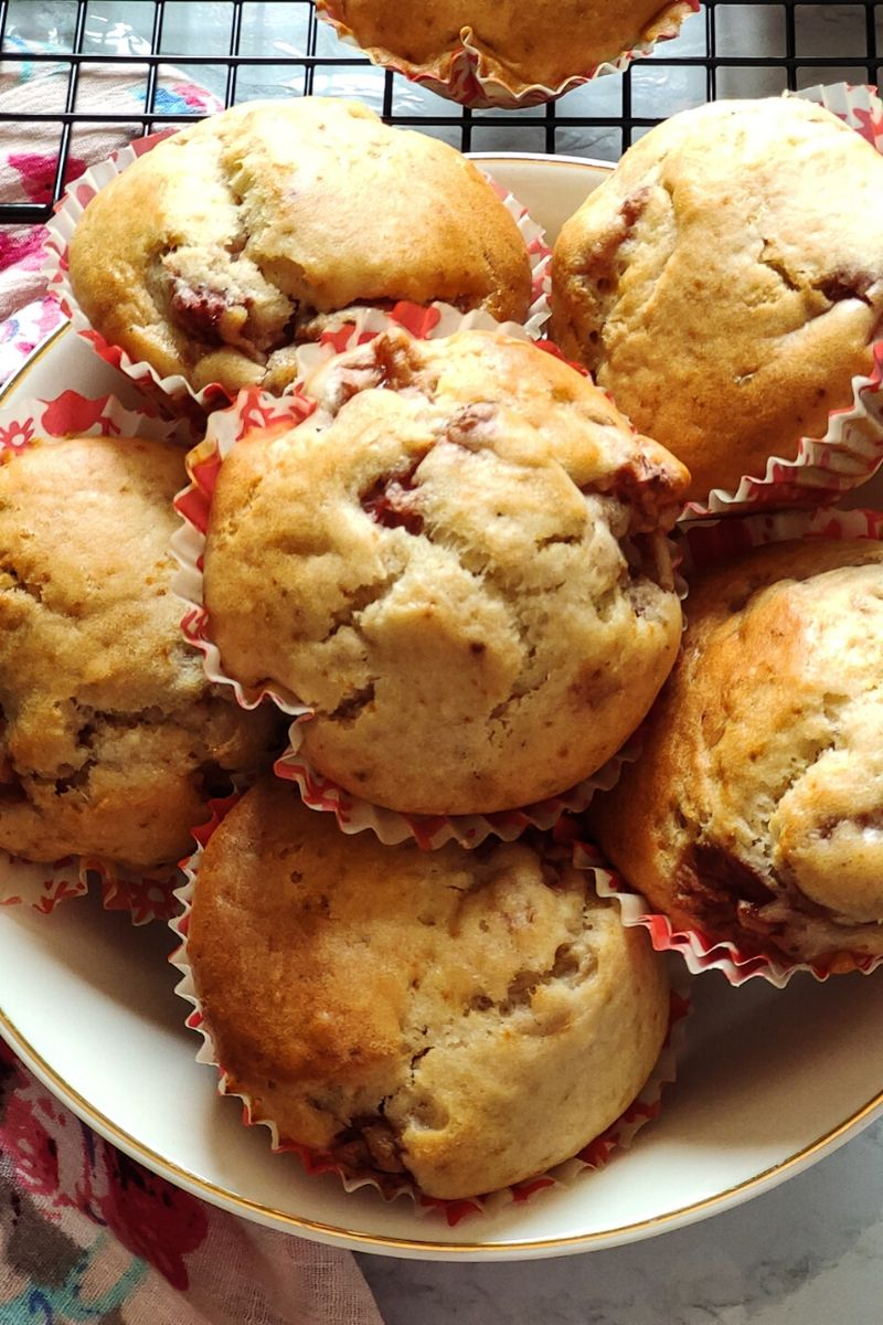 Close up shot of strawberry muffins kept in a white bowl