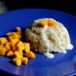 Thai mango sticky rice served on a blue plate
