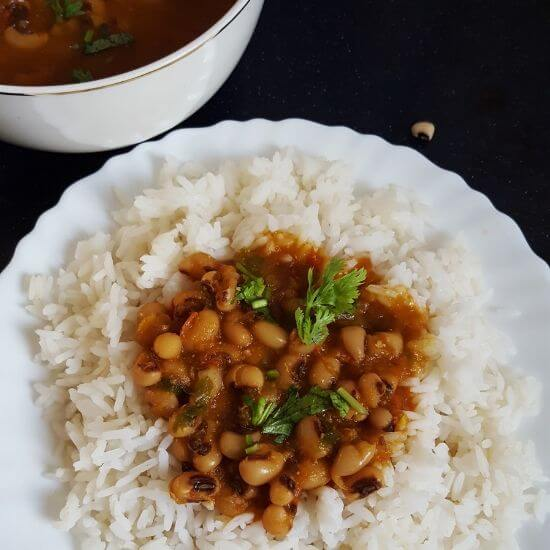 Black eyed peas curry served with rice on a plate