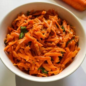 French carrot salad served in a white bowl