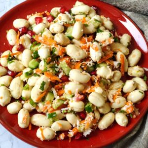 Peanut Salad served on a red plate