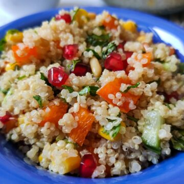 quinoa salad served in a blue bowl