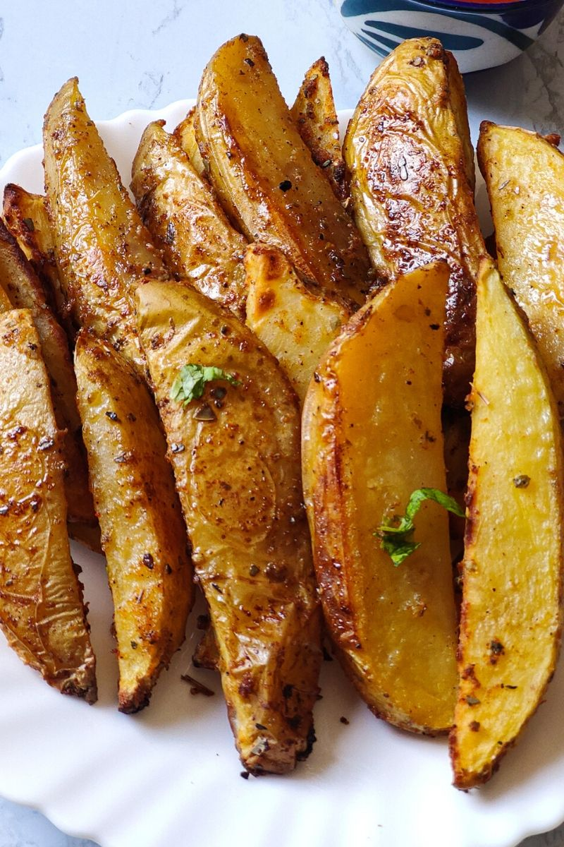 baked potato wedges served on a white plate