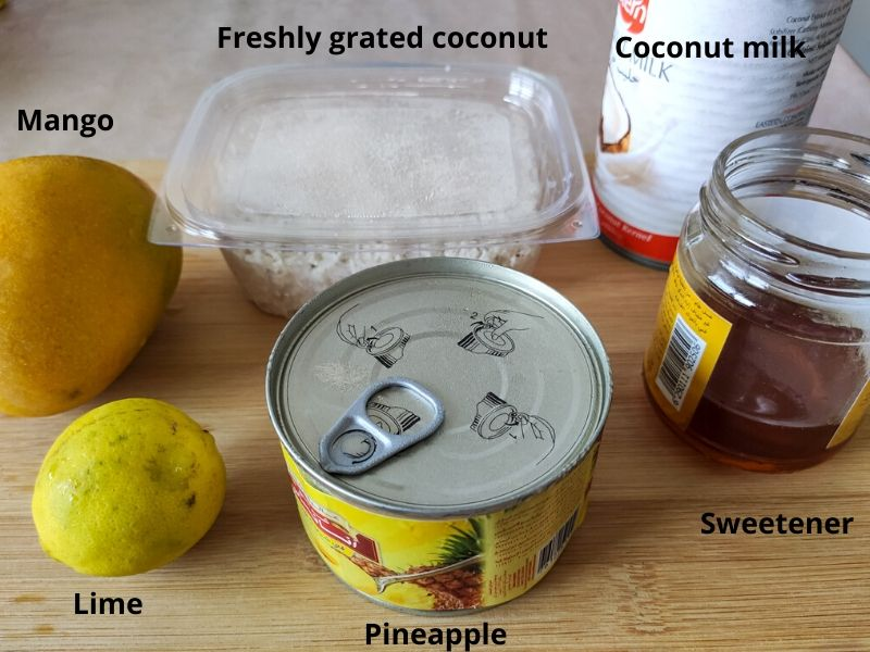 Ingredients of tropical popsicle kept on a chopping board