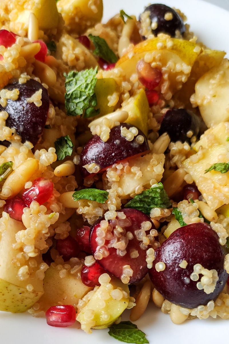 Close up shot of quinoa salad with fruits and nuts