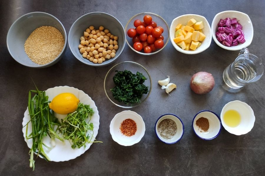 Ingredients for healthy quinoa recipe on a grey surface