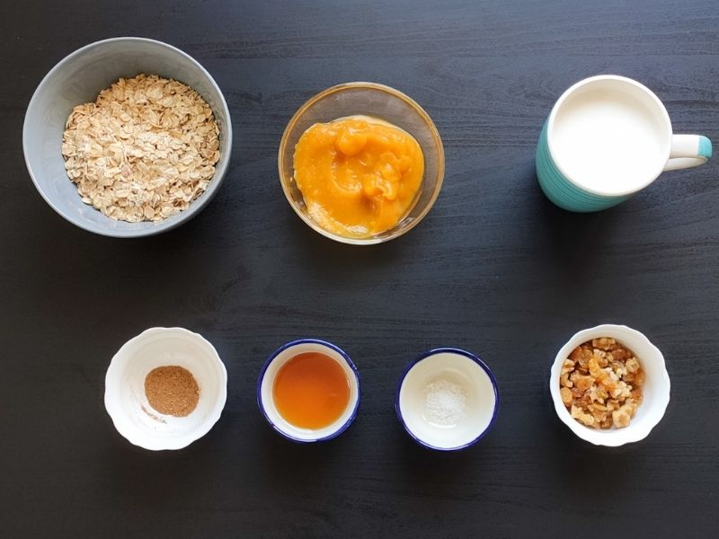 Ingredients for pumpkin oatmeal on a grey surface