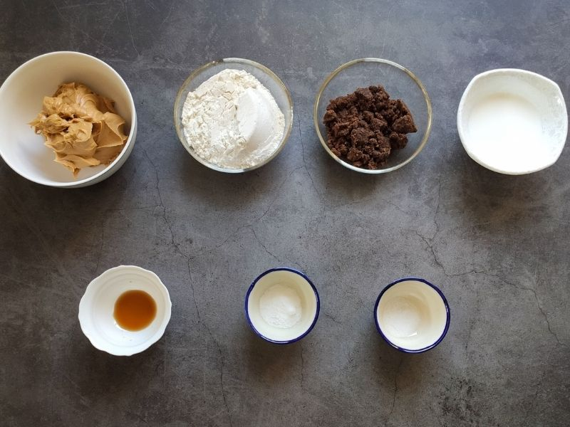 Ingredients for peanut butter cookies on a grey surface